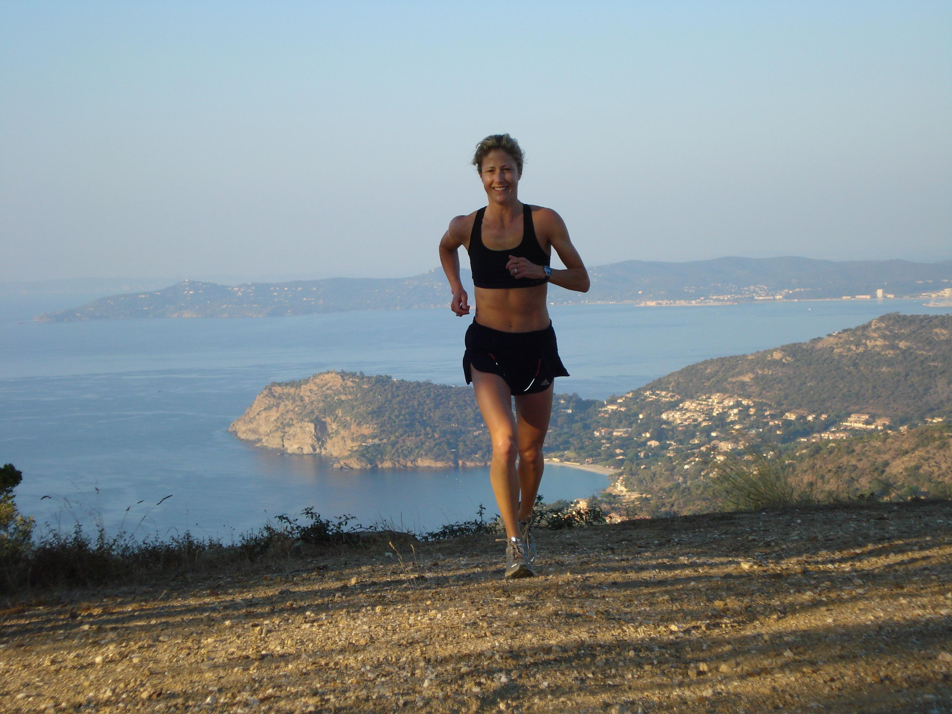 Kate trailrunning along trails above Royal South France